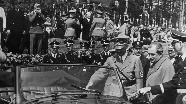Nazi leader Adolf Hitler (1889 - 1945) inspects the new, Volkswagen 'people's car' at the Fallersleben car factory, 27th May 1938.  On Hitler's left is the car's designer Dr Ferdinand Porsche