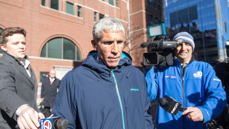 William 'Rick' Singer leaves Boston Federal Court after being charged over the college admissions scam