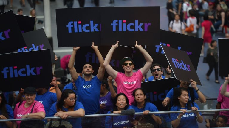 Advertising participants flash signs during an announcement that Yahoo acquired the Tumblr blogging site in order to upgrade its Flickr site, in New York, May 20, 2013. Yahoo announced a $1.1 billion deal for blogging site Tumblr aiming to help Yahoo to tap into the younger, active online user base at Tumblr. AFP PHOTO/Emmanuel Dunand (Photo credit should read EMMANUEL DUNAND/AFP/Getty Images)