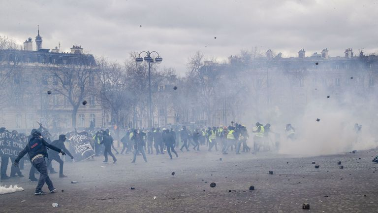 Yellow vest protesters hurl cobblestones ripped out of Paris's streets