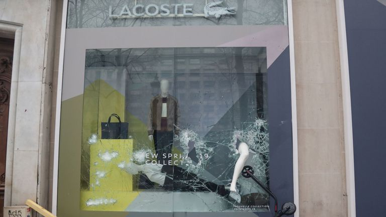 A Lacoste store had its windows smashed during the protests