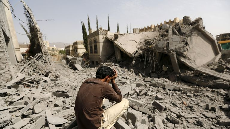 A guard sits on the rubble of the house of Brigadier Fouad al-Emad, an army commander loyal to the Houthis, after air strikes destroyed it in Sanaa, Yemen June 15, 2015. REUTERS/Khaled Abdullah/File Photo