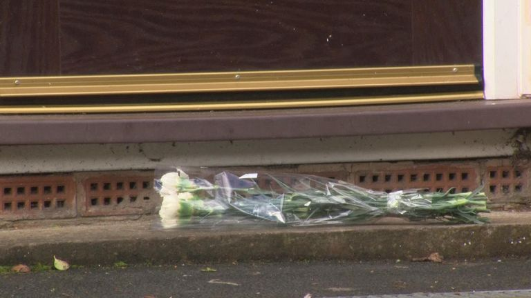 Flowers were laid on the pavement outside Yousef's family home
