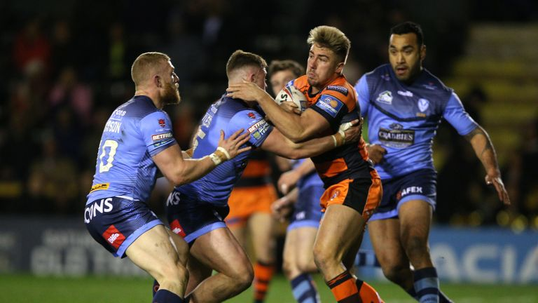 Castleford Tigers' Greg Minikin is tackled by St Helens' Regan Grace during the Betfred Super League match at the Mend-A-Hose Jungle, Castleford.