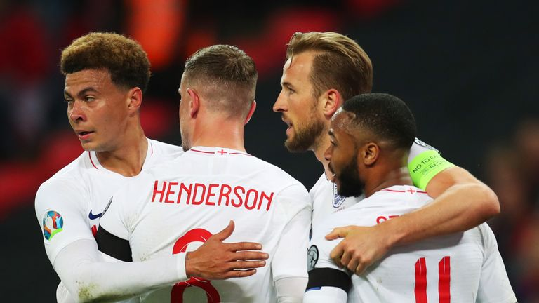 Harry Kane of England (2R) celebrates as scores his team's second goal from a penalty with Raheem Sterling, Jordan Henderson and Dele Alli during the 2020 UEFA European Championships Group A qualifying match between England and Czech Republic at Wembley Stadium on March 22, 2019 in London, United Kingdom.