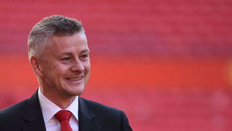 Ole Gunnar Solskjaer is seen during a photo call at Old Trafford after it was announced that he was appointed as the clubs full-time manager on a three-year contract