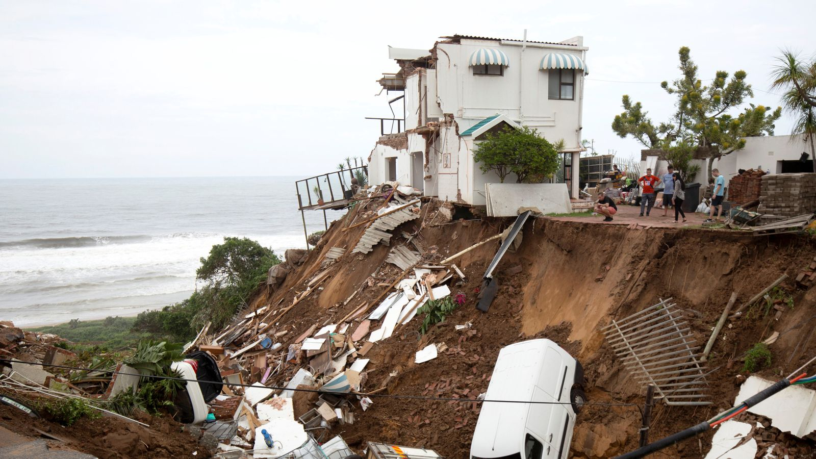 Flooding and mudslides kill at least 60 people in South Africa