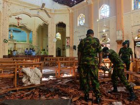 Security personnel inspect the interior of St. Sebastian's Church in Negombo