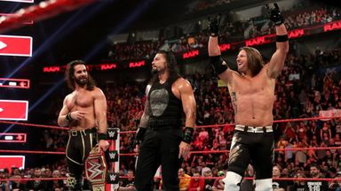 AJ Styles fights alongside Rollins & Reigns