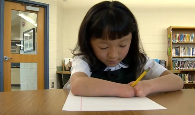 10-year-old girl born without hands wins handwriting competition