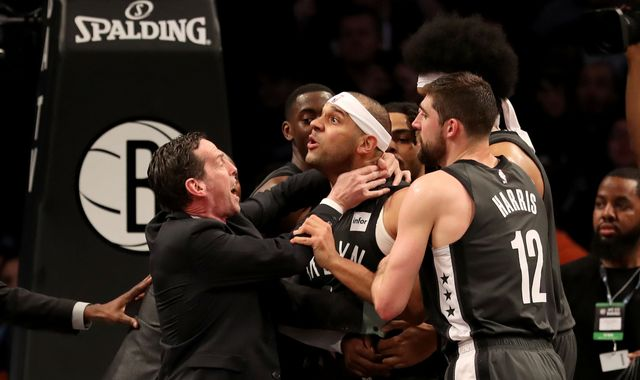 Watch as Jimmy Butler and Jared Dudley are ejected after melee spills into stands