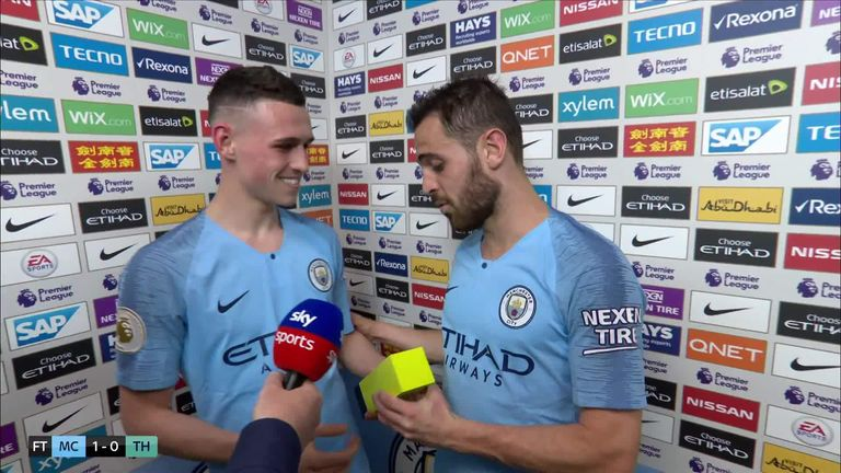 Bernardo Silva handed Phil Foden his man-of-the-match award after the game