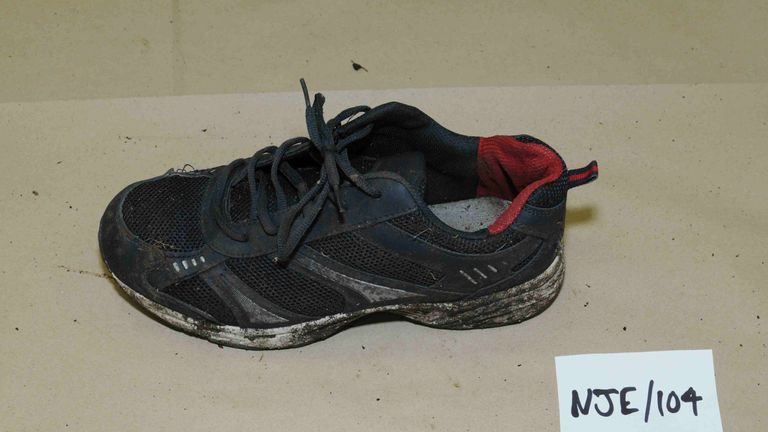 A pair of dark trainers with a white sole were found next to the skeleton