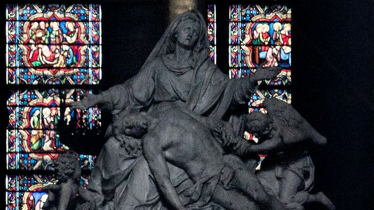 The marble statue Pieta, by Nicolas Coustou, at the altar in Notre Dame after the fire