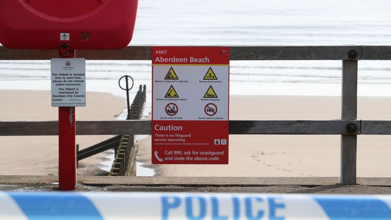 Warning signs inside a police cordon on Aberdeen beach where two people were pulled from the sea by the RNLI and taken to hospital where they died. Emergency services were called to the scene in Aberdeen in the early hours of Friday following a report that two females were in the water. PRESS ASSOCIATION Photo. Picture date: Friday April 19, 2019. See PA story RESCUE Beach. Photo credit should read: Jane Barlow/PA Wire