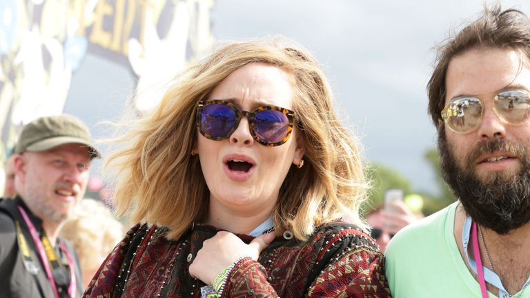 Adele with her husband Simon Konecki backstage at The Pyramid Stage at the Glastonbury Festival, at Worthy Farm in Somerset. PRESS ASSOCIATION Photo. Picture date: Saturday June 27, 2015. Photo credit should read: Yui Mok/PA Wire