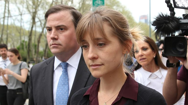 Actress Allison Mack (R) departs the United States Eastern District Court after a bail hearing in relation to the sex trafficking charges filed against her on May 4, 2018 in the Brooklyn borough of New York City