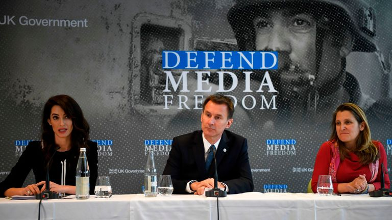 Amal Clooney, Jeremy Hunt and Canadian foreign minister, Chrystia Freeland, at a news conference in France