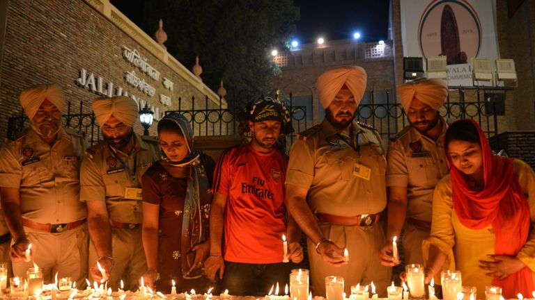 Indian Punjab Police personnel light candles as they pay tribute to those who died in the Amritsar massacre