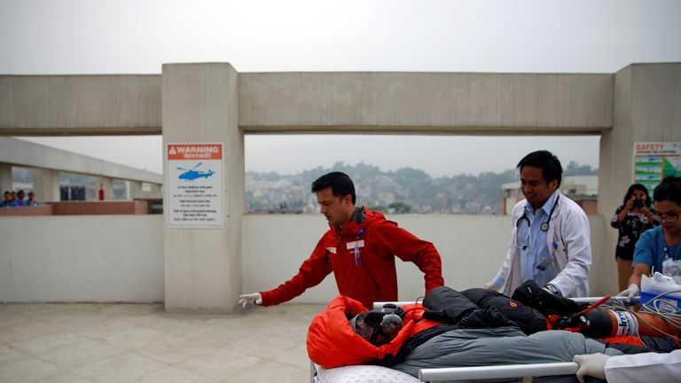 Malaysian climber Wui Kin Chin is being transferred from a helicopter to the hospital for treatment after being rescued from Mount Annapurna in Kathmandu, Nepal April 26, 2019
