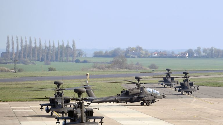 Apache helicopters take off from Wattisham Airfield in Suffolk, as they head to the Baltics for a three-month deployment