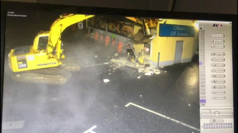 The raid lasted under 5 minutes, after which masked men drove off in a car with the cash machine placed in a hole cut in the roof.