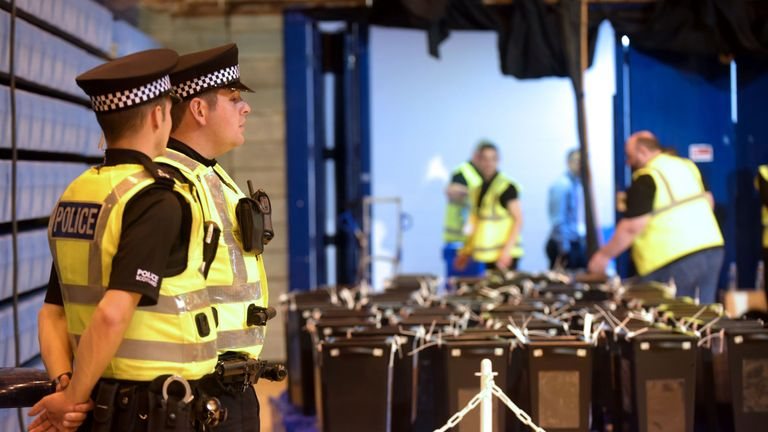 TOPSHOT - Police stand guard as the ballot boxes arrive at the Meadowbank Sports Centre counting centre in Edinburgh, Scotland, on June 8, 2017, after the polls closed in the British general election. Prime Minister Theresa May's Conservatives are set to lose their overall majority after Britain's general election, an exit poll showed on Thursday after voting closed. / AFP PHOTO / Lesley Martin (Photo credit should read LESLEY MARTIN/AFP/Getty Images)