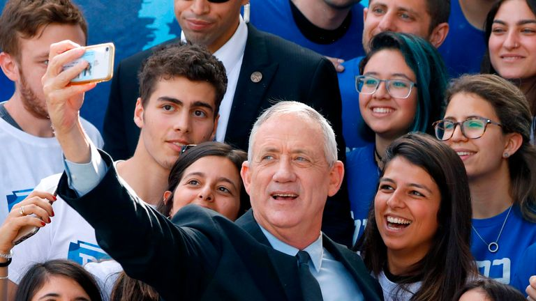 Retired Israeli general Benny Gantz, one of the leaders of the Blue and White (Kahol Lavan) political alliance, takes a picture with his supporters during a campaign event in the coastal city of Tel Aviv on April 8, 2019, a day ahead of the electoral polls. (Photo by JACK GUEZ / AFP) (Photo credit should read JACK GUEZ/AFP/Getty Images)