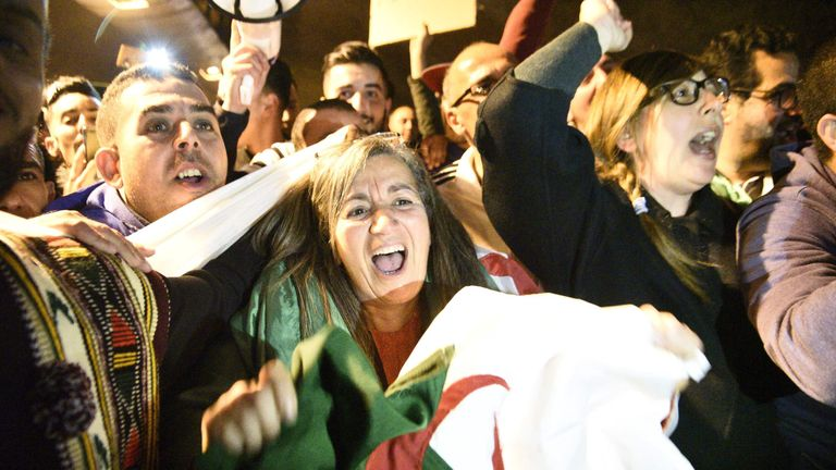 Algerians celebrate the resignation