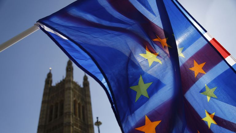 An activist waves a combination of the Union and the EU flags near the Houses of Parliament in central London on April 10, 2019. - The EU's chief Brexit negotiator said Tuesday that the length of any delay to the divorce that the bloc may grant Britain will depend on what plan Prime Minister Theresa May brings to a crunch summit. (Photo by Tolga AKMEN / AFP) (Photo credit should read TOLGA AKMEN/AFP/Getty Images)