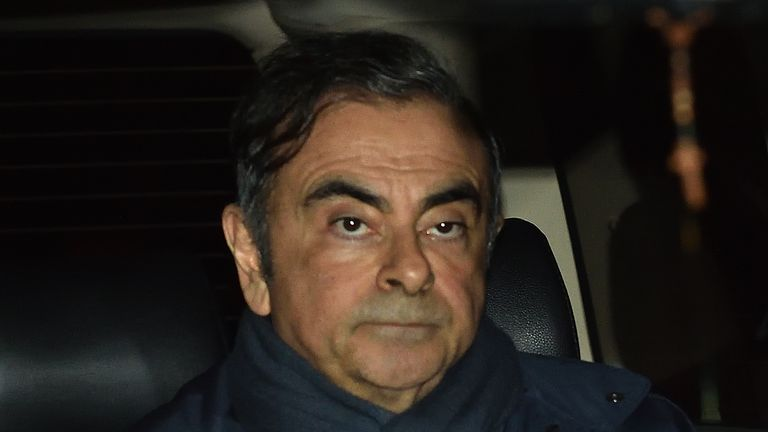 Former Nissan Chairman Carlos Ghosn leaves the office of his lawyer Junichiro Hironaka in Tokyo on April 3, 2019