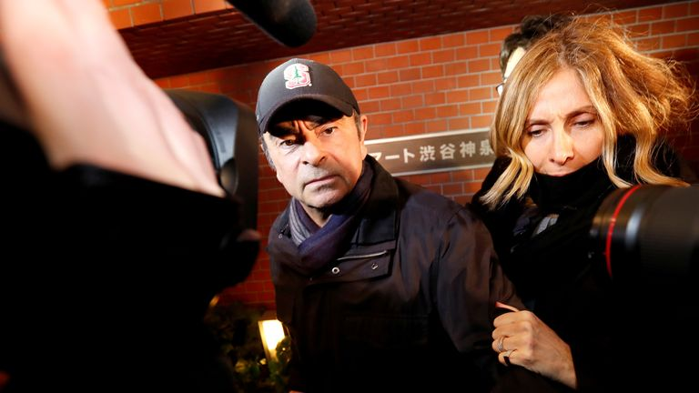 Former Nissan Motor Chairman Carlos Ghosn accompanied by his wife Carole Ghosn, arrives at his place of residence in Tokyo, Japan, March 8, 2019