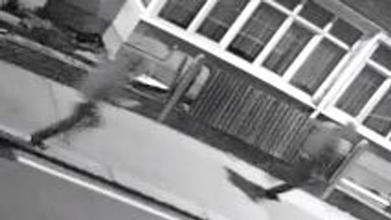 CCTV footage shows two men approach Mr Brown on his bike shortly before he is stabbed