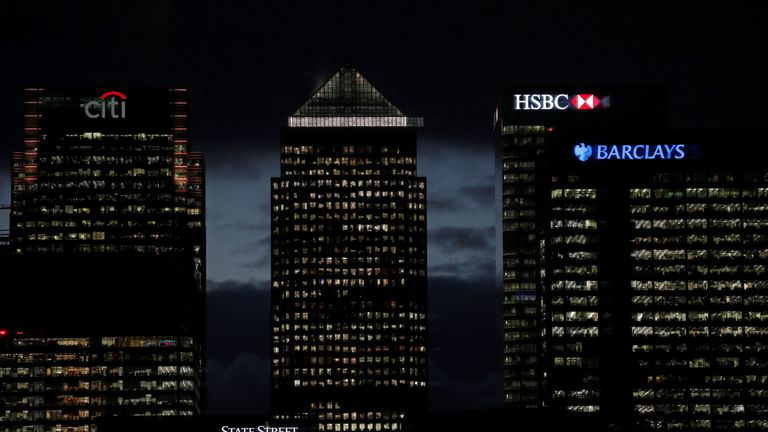 The financial offices of banks, including Barclays, Citi, and HSBC are pictured at dusk alongside One Canada Square  in the financial district of Canary Wharf, in London on November 19, 2018