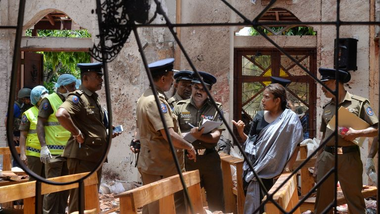 Crime scene officials inspect the site of a bomb blast inside a church in Negombo, Sri Lanka April 21, 2019