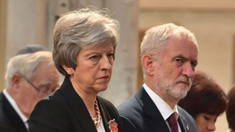 Britain's Prime Minister Theresa May (L) and opposition Labour Party leader Jeremy Corbyn (R) attend a Service of Remembrance for members of the House of Commons and House of Lords in St Margaret's church in Westminster, central London, on November 6, 2018