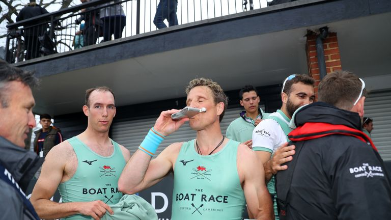 Cracknell takes a swig from a flask after the race