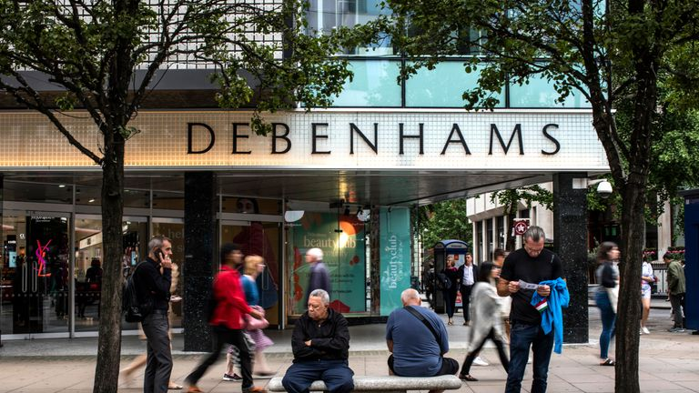 Members of the public walk past a Debenhams store on Oxford Street on September 11, 2018 in London, England