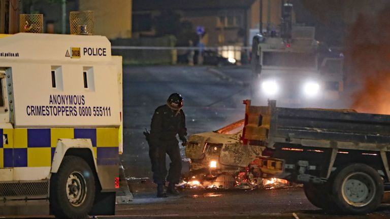 A PSNI officer conducts a search after shots where reportedly fired in Creggan, Londonderry. PRESS ASSOCIATION Photo. Picture date: Thursday April 18, 2019. Photo credit should read: Niall Carson/PA Wire