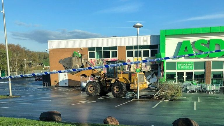 The digger was discovered in the Asda car park on Thursday morning. Pic: @WilVernon