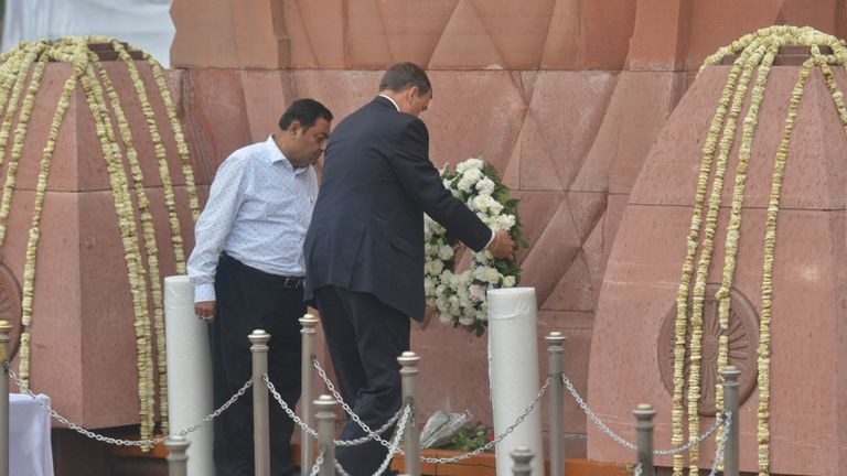 Dominic Asquith (C) lays a wreath in tribute on the 100th anniversary of the Jallianwala Bagh massacre