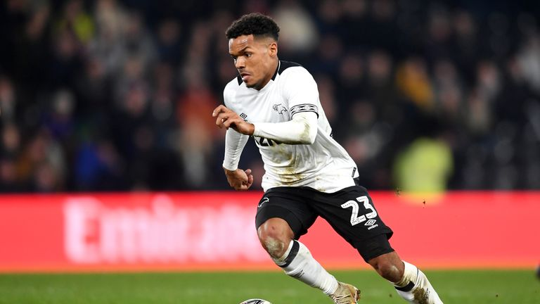 A Brentford season ticket-holder was arrested on suspicion of directing racist abuse at Derby's Duane Holmes while the player was in the dugout