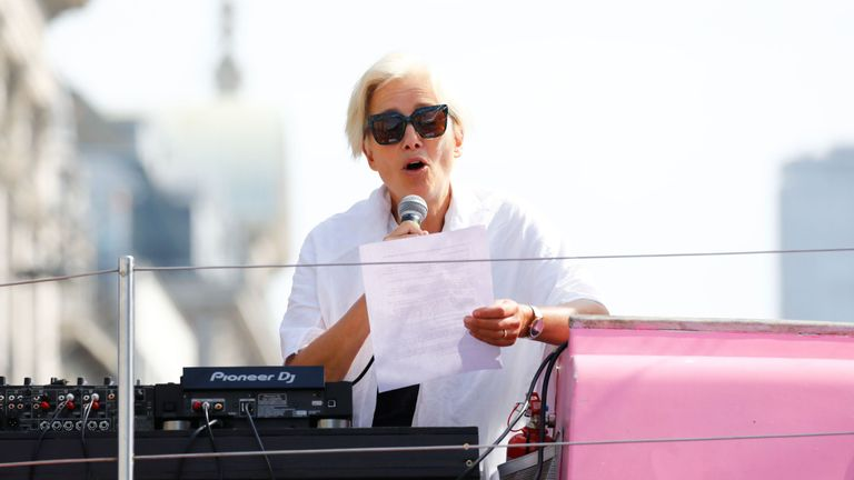 British actress Emma Thompson gives an address from the stage atop the pink boat to climate change activists occupying the road junction at Oxford Circus in central London on April 19, 2019 during the fifth day of an environmental protest by the Extinction Rebellion group