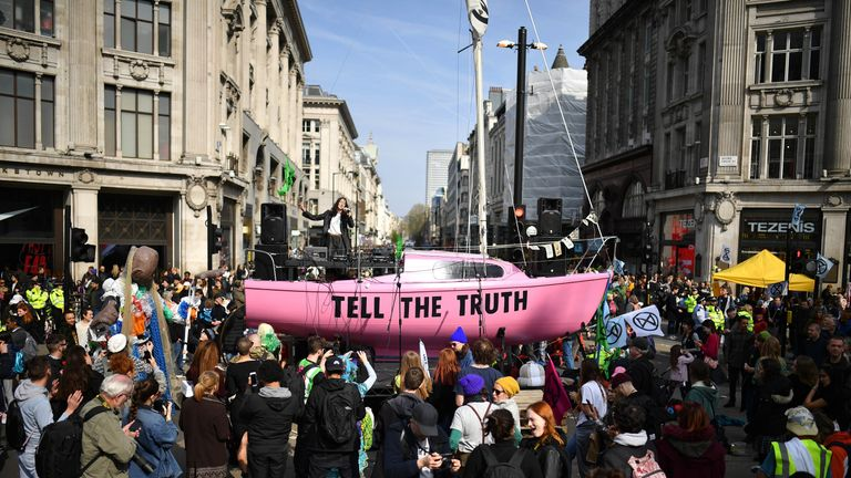 LONDON, ENGLAND - APRIL 15: Jessica Winter sings on a boat placed in the center of a traffic junction as Environmental campaigners block Oxford Circus during a coordinated protest by the Extinction Rebellion group on April 15, 2019 in London, England. With demonstrations blocking a number of locations across the capital, the group aims to stop traffic for up to five days. (Photo by Leon Neal/Getty Images)