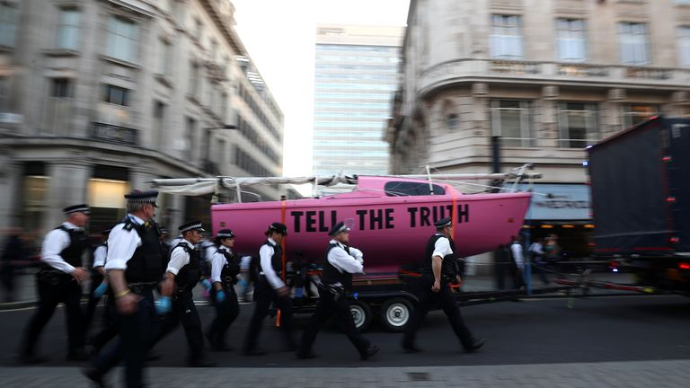 Police have dismantled and removed a pink boat that had been parked at Oxford Circus for five days as part of the climate protest.