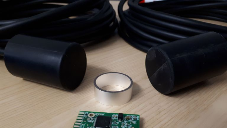 A circuit board and transducer that are then encapsulated to produce the black device to create a miniature acoustic transponder