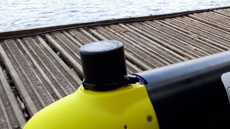 A miniature acoustic undersea transponder, used to locate fishing nets, mounted on the nose of an autonomous underwater vehicle