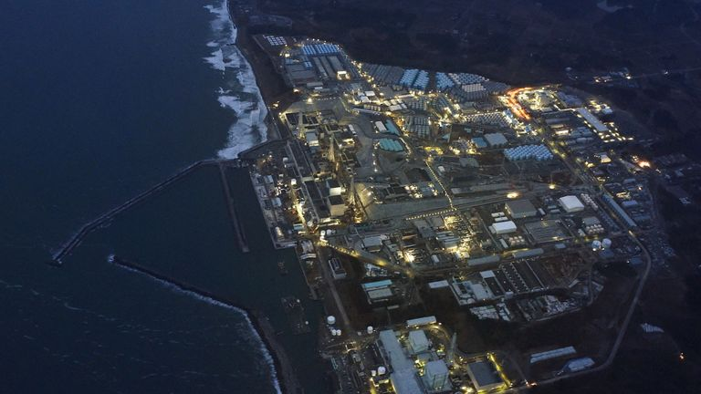 Tsunami-crippled Fukushima Daiichi nuclear power plant is illuminated for decommissioning operation in the dusk in Okuma town, Fukushima prefecture, Japan, in this aerial view photo taken  March 10, 2016, a day before the five-year anniversary of the March 11, 2011 earthquake and tsunami disaster.