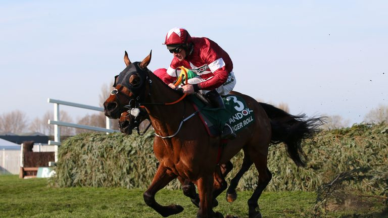 Tiger Roll, ridden by Davy Russell, races to victory in the Grand National