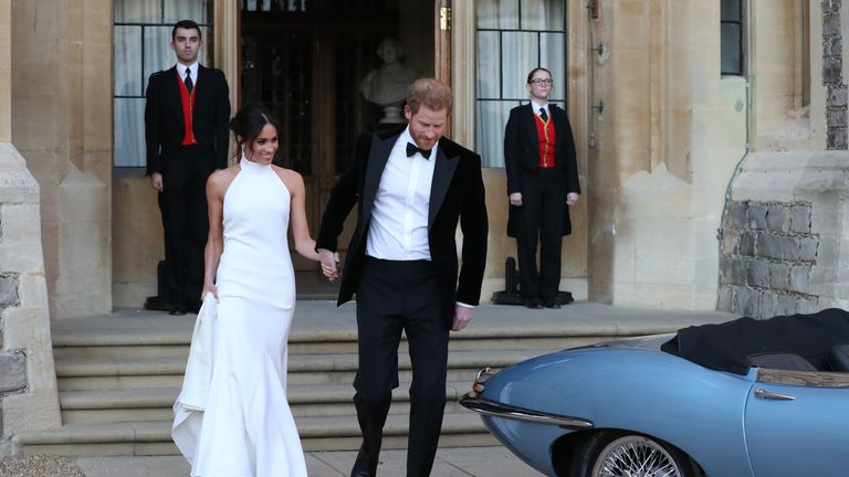 Harry and Meghan head to their wedding reception at Frogmore House on 19 May last year